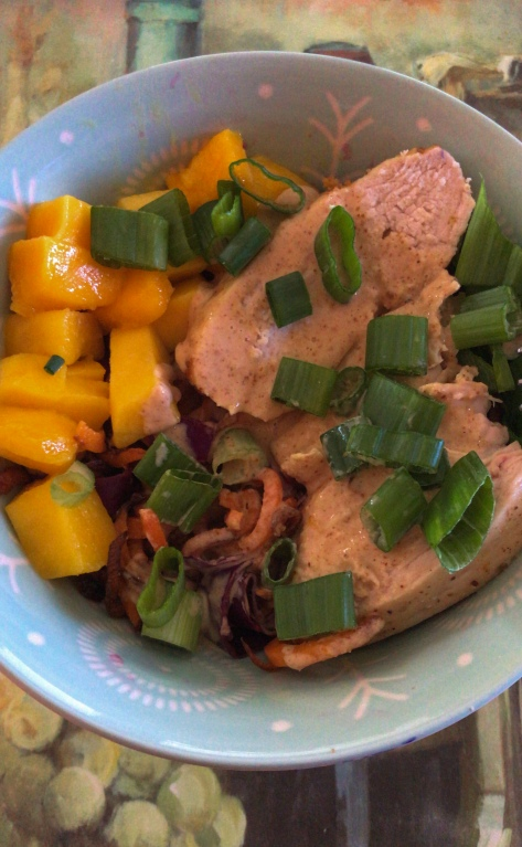 Thai chicken and carrot spiral bowl with pickled cabbage and almond butter sauce