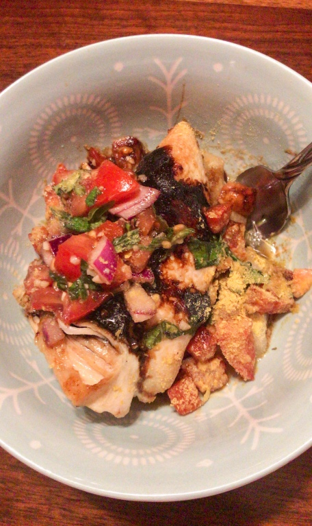 Bruschetta chicken over cauliflower gnocchi with nutritional yeast
