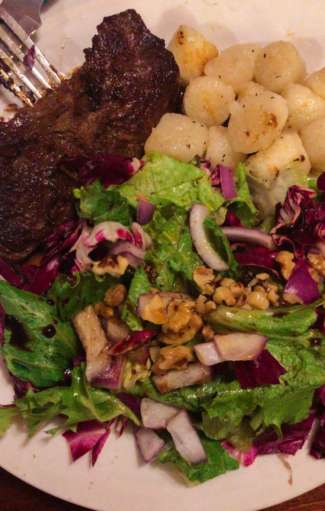 Marinate flank steak with cauliflower gnocchi and a side salad